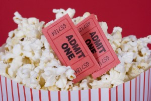 Popcorn with two admit tickets in a popcorn bag